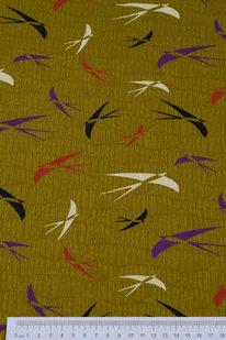 DKB 459 Bavlněné plátno zelené s vlaštovkami